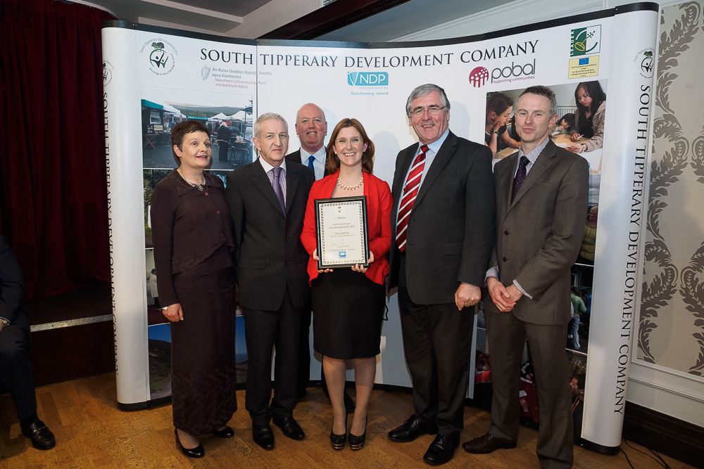 STDC Carrick-On-Suir Entrepreneur of the Year 2013 Sandra O'Neill being presented with her award by Tom Hayes, Minister of State. Also in picture L-R, Isabel Cambie STDC (RDP Manager), Martin Quinn STDC (Chairman), Niall Morrissey STDC (CEO)