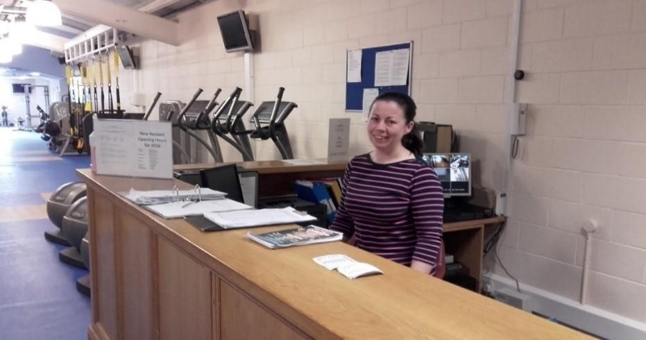 Tús participant Margaret Ryan managing the Gym reception area