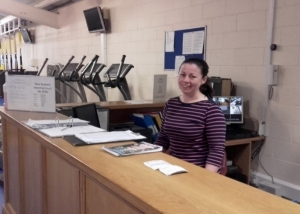 Tús participant Margaret Ryan managing the Gym reception area